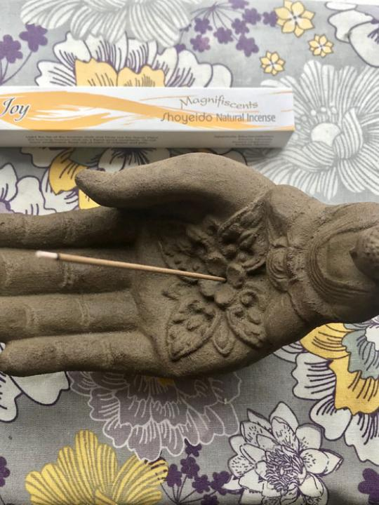 Hand with Buddha Incense Holder